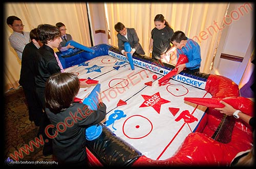 inflatable hose hockey game